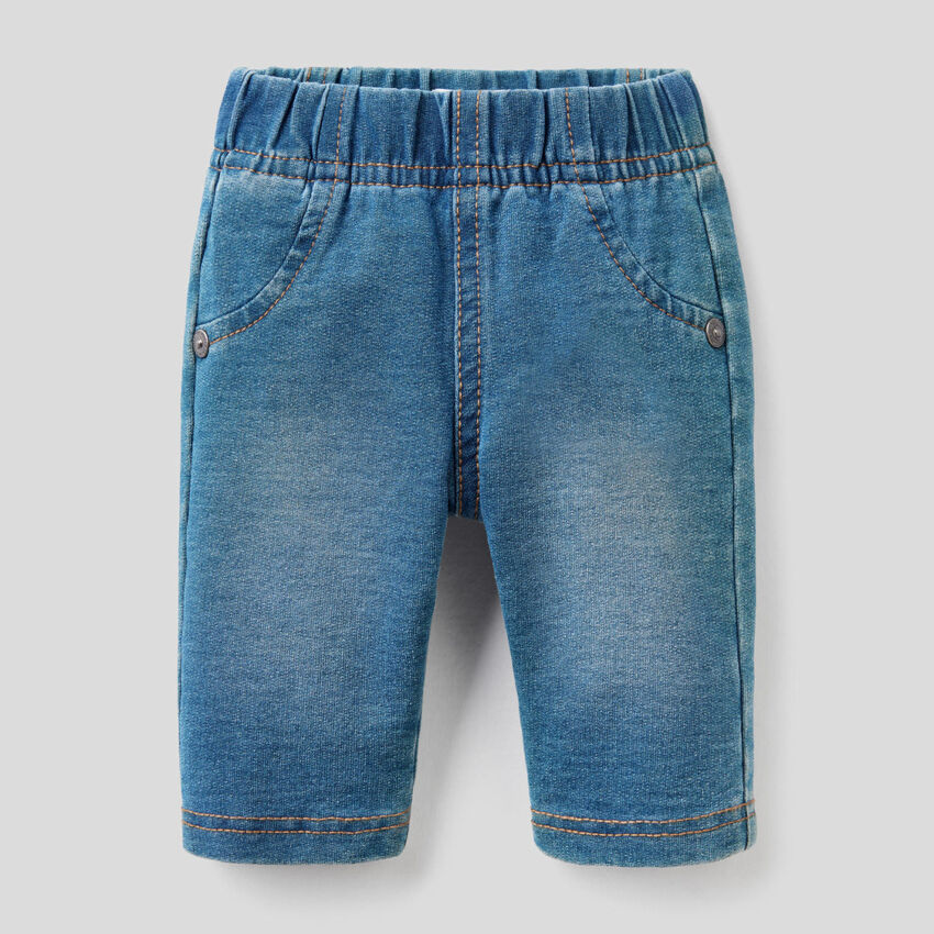 Denim look trousers with face applique