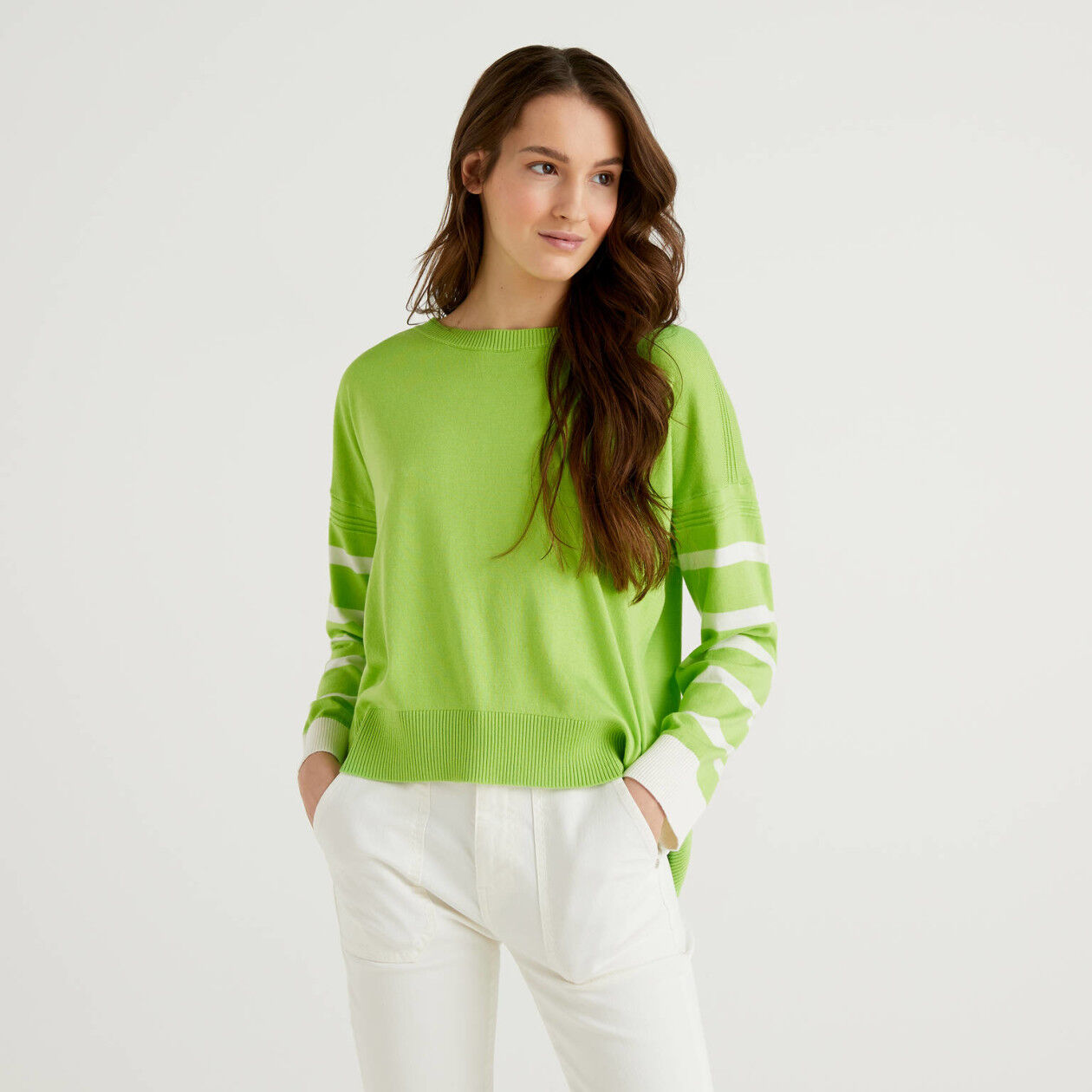 Light green sweater with slit on the back