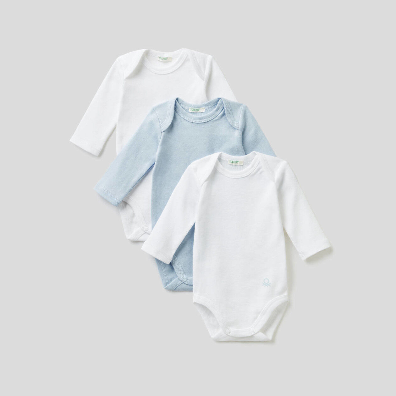 Three organic cotton onesies