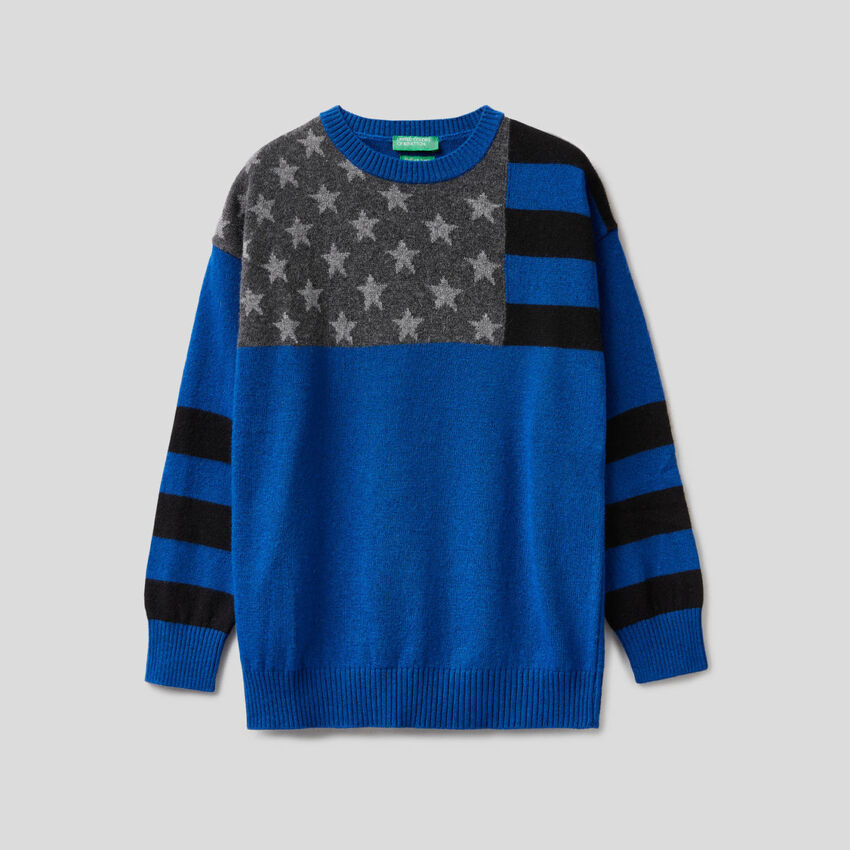 Light blue sweater with flag inlay
