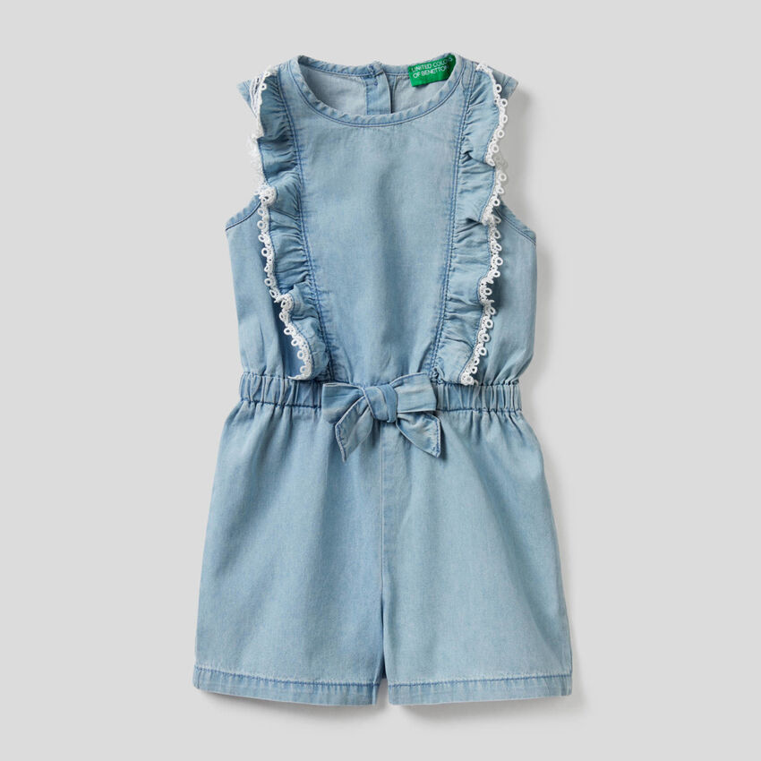 Short jumpsuit in light denim